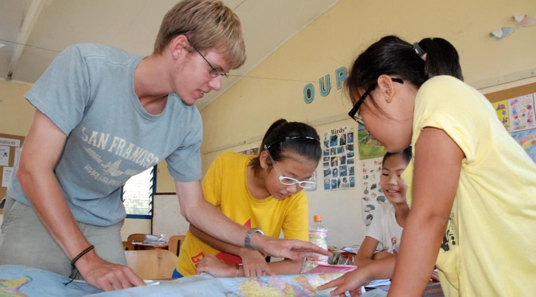 Students learn about basic geography from a volunteer teaching in Fiji